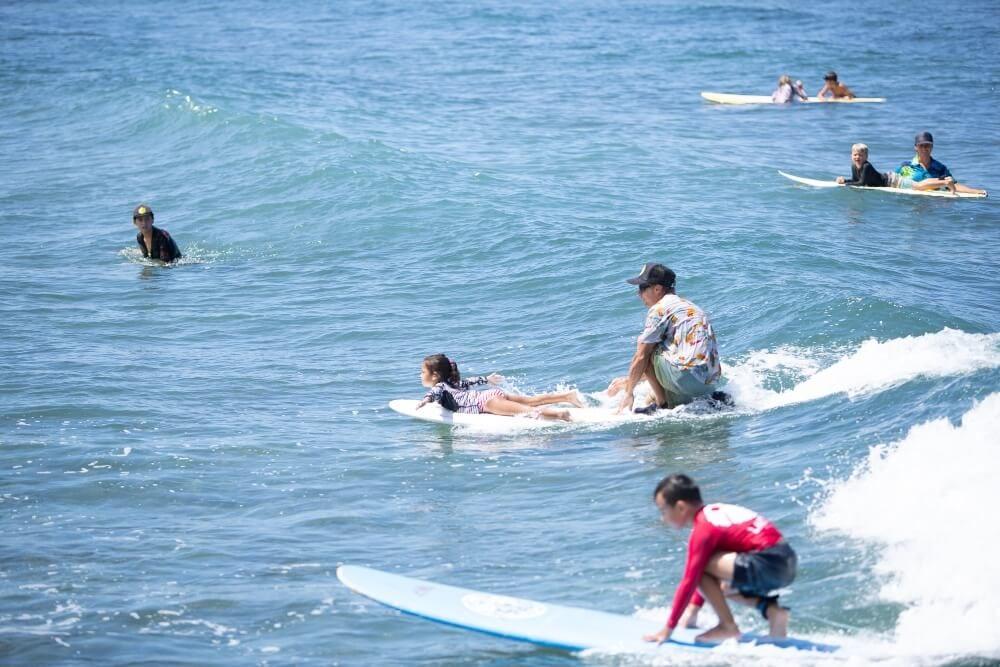 Surf camp at breakwall in Lahaina, Maui